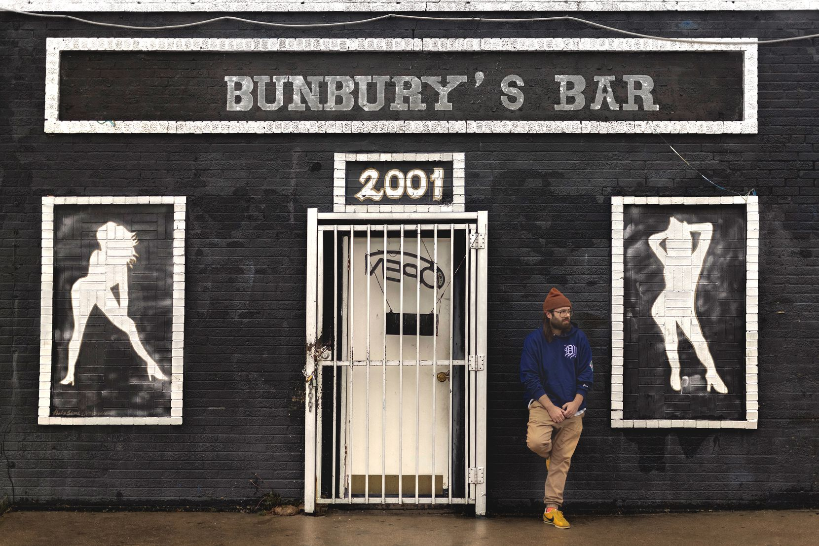 "Dallas-based musician Donovan Jones stands in front of Bunbury's Bar. His song entitled ""Geraldine"" embraces themes of hope and acceptance."