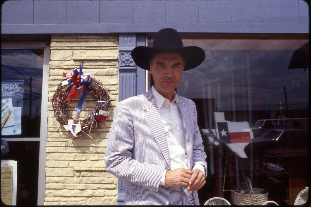 David Byrne poses in front of a Mansfield store during filming.
