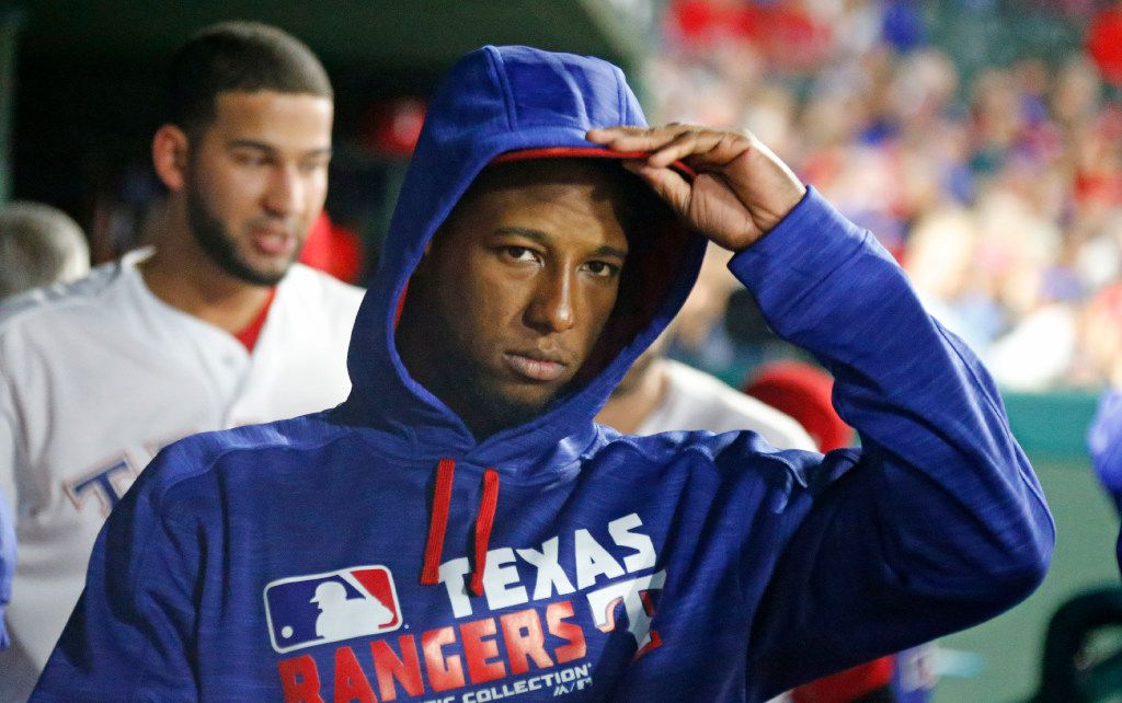 Texas Rangers third baseman Jurickson Profar (19) dons a sweatshirt as the temperature drops to much lower levels  at the stadium during the Milwaukee Brewers vs. the Texas Rangers major league baseball game at Globe Life Park in Arlington on Monday, September 26, 2016. (Louis DeLuca/The Dallas Morning News)