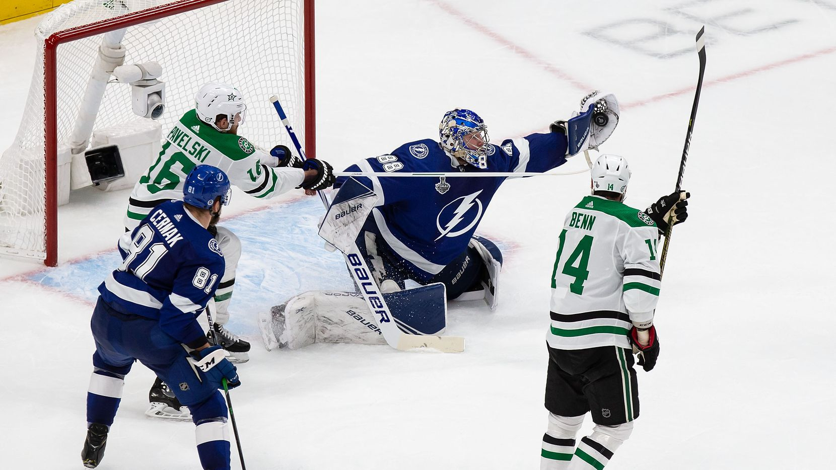 Joe Pavelski (16) and Jamie Benn (14) of the Dallas Stars attack the net as goaltender Andrei Vasilevskiy (88) of the Tampa Bay Lightning makes a save during Game Two of the Stanley Cup Final at Rogers Place in Edmonton, Alberta, Canada on Monday, September 21, 2020.