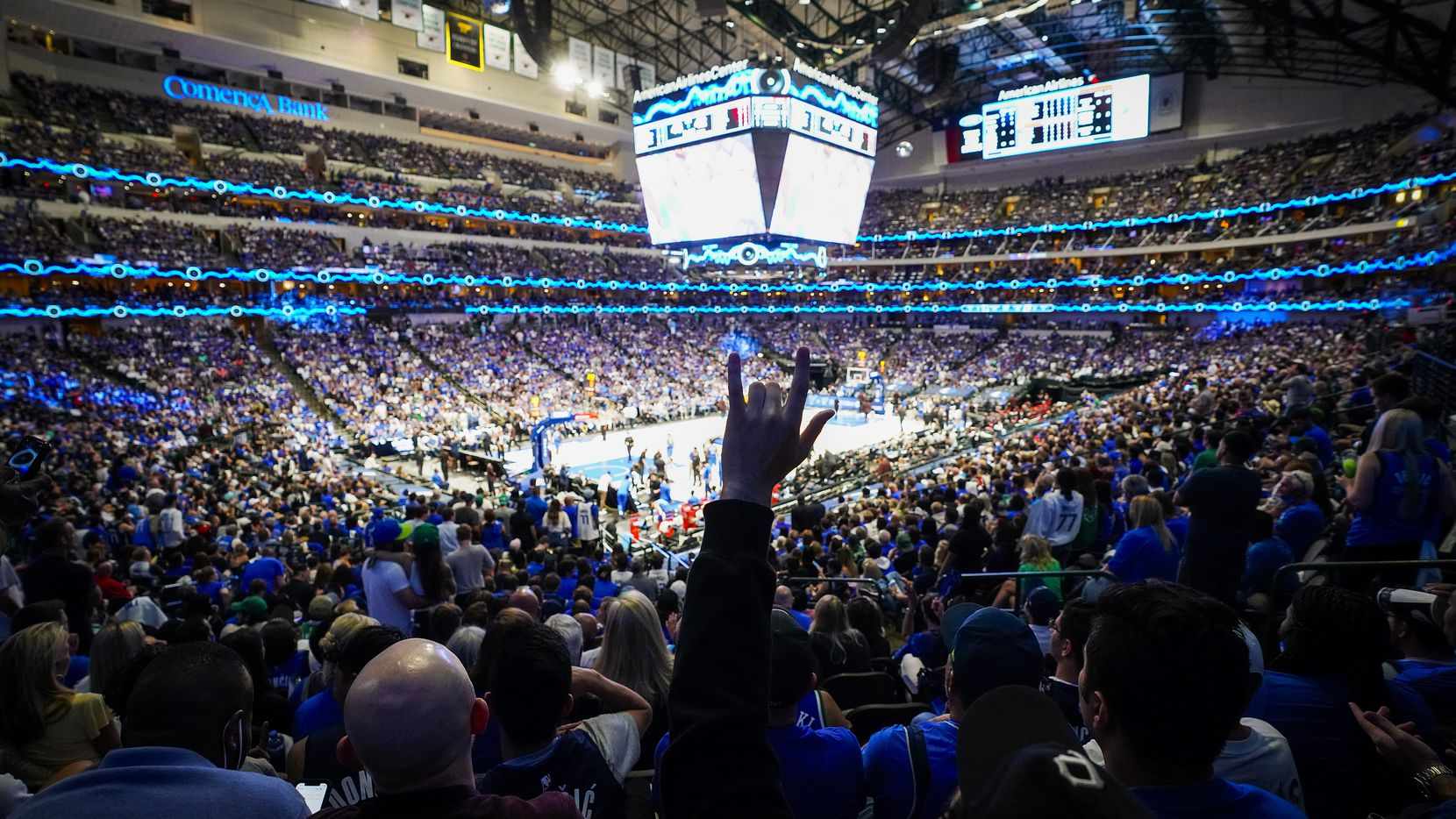 Dallas Mavericks fans cheer a basket during the first half of an NBA playoff basketball game at the American Airlines Center on Friday, June 4, 2021, in Dallas.