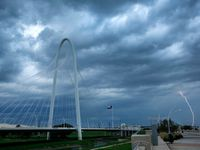 Lightning strikes in West Dallas as a thunderstorms roll past the Margaret Hunt Hill Bridge, Wednesday evening, July 10, 2019. A large storm associated with a cool front pushed a large thunderstorm down from Oklahoma. (Tom Fox/The Dallas Morning News)