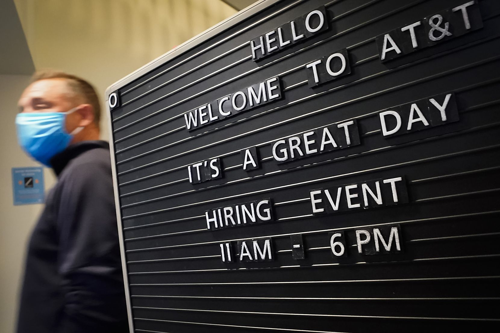 A sign welcomed job candidates to an AT&T hiring event on April 28 in Richardson. The company was hiring for 300 jobs across the Dallas-Fort Worth area in retail, virtual sales and customer acquisition roles.