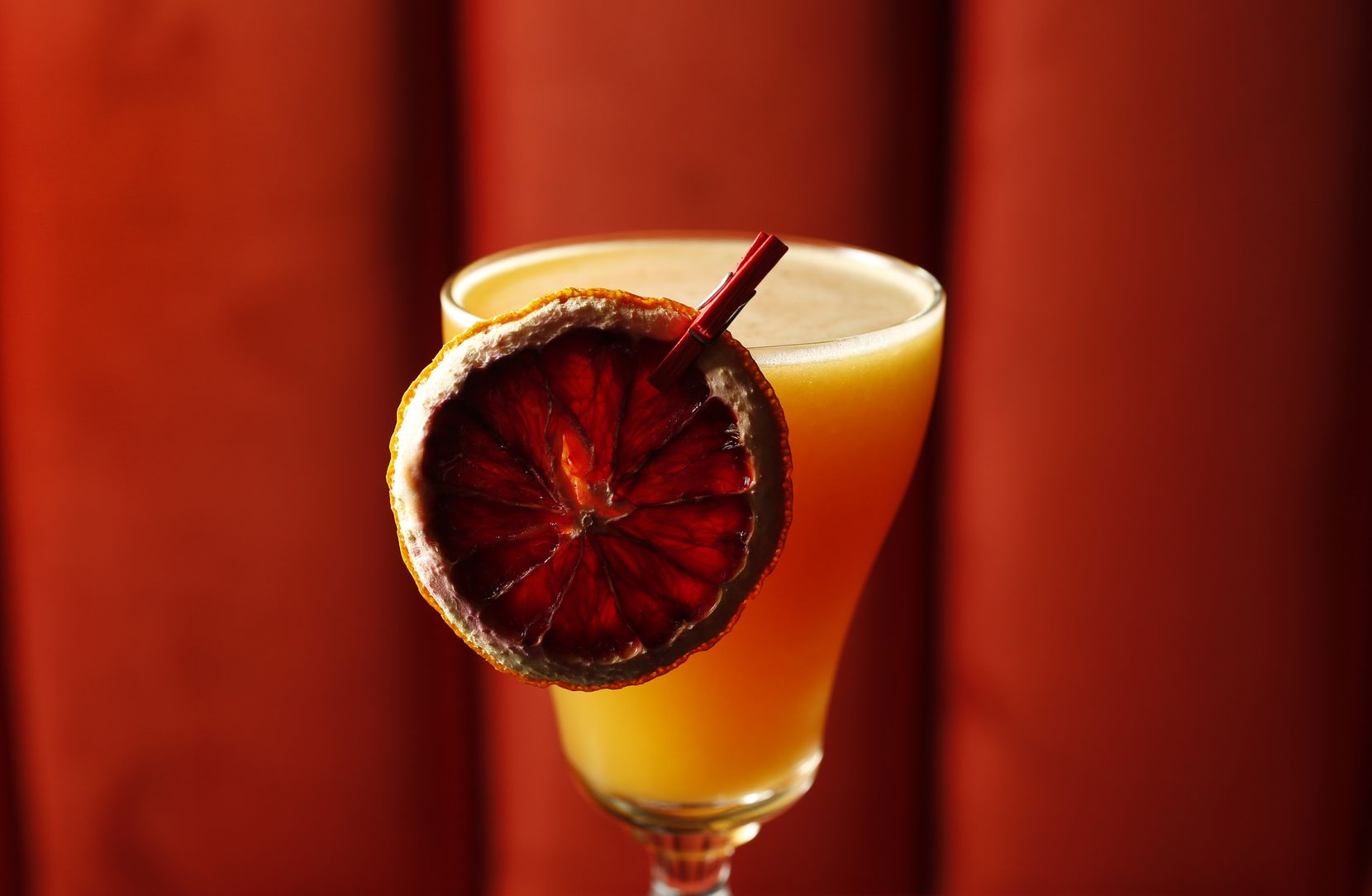 The Tuk Tuk  at Akai is made with with Remy Martin VSOP, Mandarine Napoleon, Ty Ku Soju, passion fruit, ginger reduction and lemon juice.