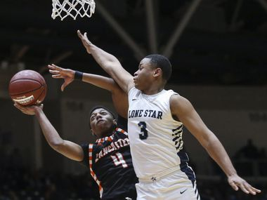 Lancaster's Wade Taylor (4) attempts to get a shot past Frisco Lone Star's T'Mari Jones (3) during the second half a boys basketball Class 5A Region II semifinal between Frisco Lone Star and Lancaster on Friday, March 1, 2019 at the Curtis Culwell Center in Garland, Texas. Frisco Lone Star beat Lancaster 60-56.