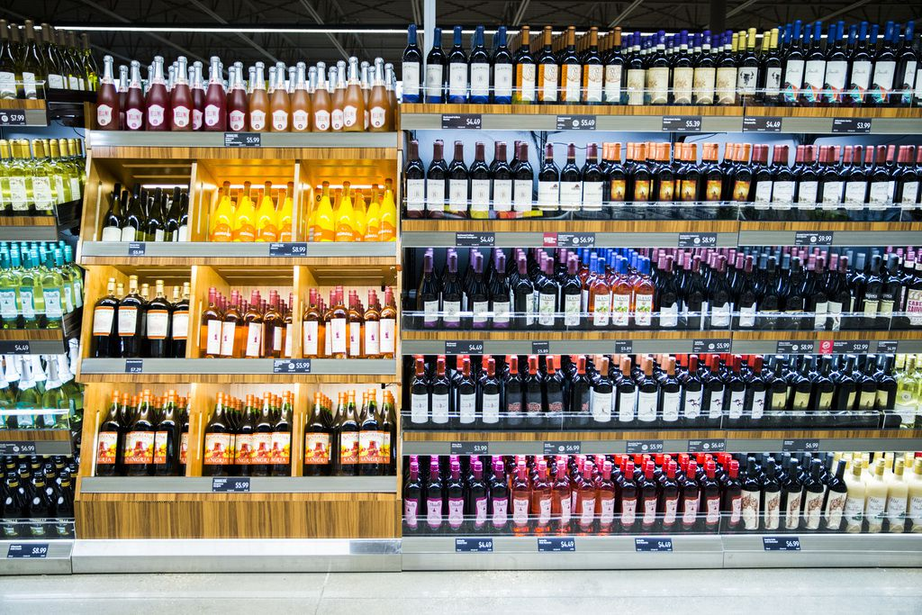 The wine section of a newly renovated Aldi grocery store on Gaston Avenue on Thursday, September 20, 2018 in Dallas. Many restaurants are offering drink specials during the coronavirus shelter in place. (Ashley Landis/The Dallas Morning News)
