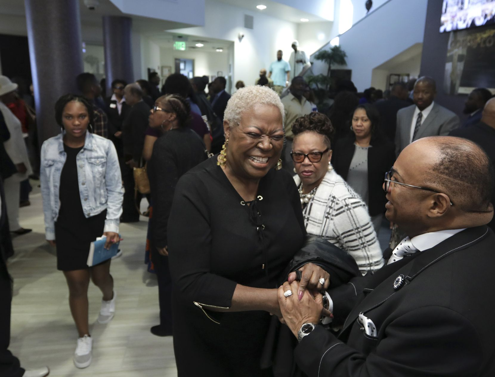 Pastor Isiah Joshua Jr. (right) meets with members of the congregation at Shiloh Missionary Baptist Church in Plano on Feb. 2, 2020.