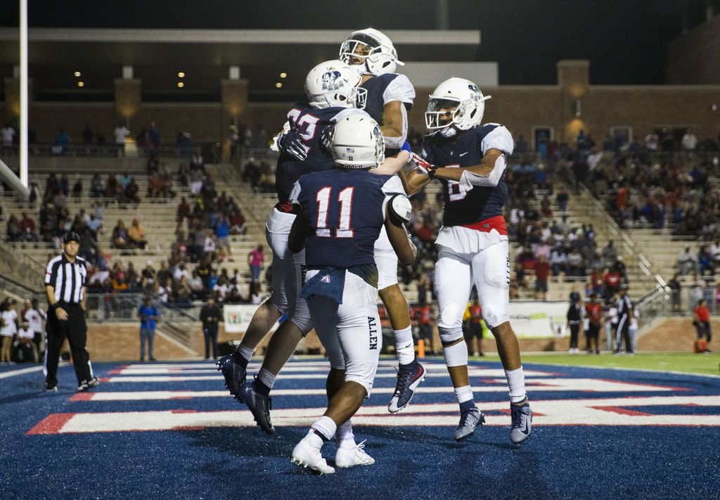 Allen running back Justin Hall (32) celebrates a touchdown with team mates during the fourth quarter of a high school football game between Allen and Cedar Hill on Friday, August 30, 2019 at Eagle Stadium in Allen. (Ashley Landis/The Dallas Morning News)