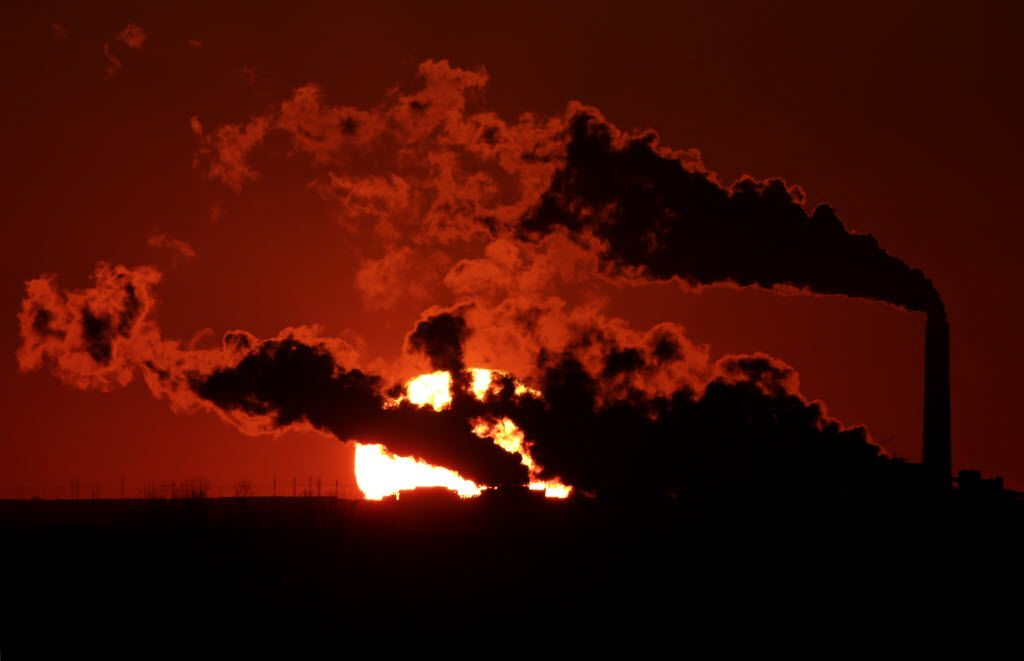 In this March 8, 2014 file photo, steam from the Jeffrey Energy Center coal-fired power plant is silhouetted against the setting sun near St. Mary's, Kan.
