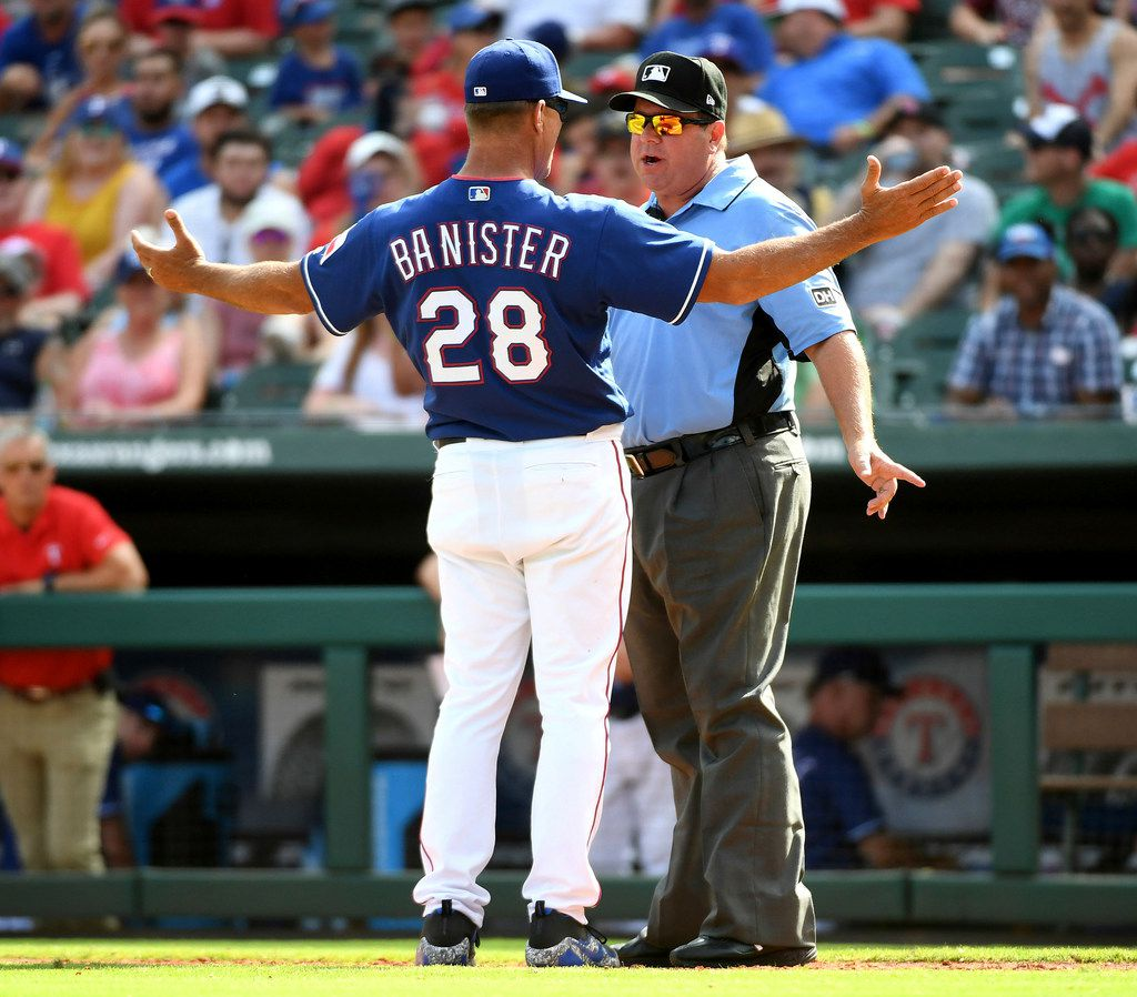 Texas Rangers manager Jeff Banister (28) argues with third base umpire Sam Holbrook after Rangers relief pitcher Keone Kela was called for a balk which gave the Houston Astros the winning run during the ninth inning of a baseball game, Sunday, June 10, 2018, in Arlington, Texas. Banister was ejected. (AP Photo/Jeffrey McWhorter)