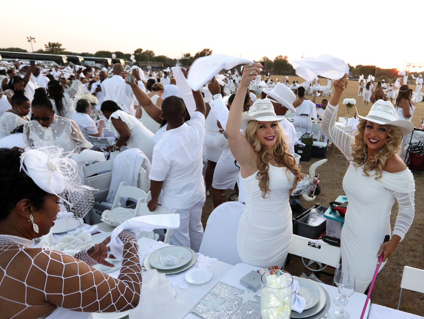 Guests wave their napkins during the Diner en Blanc event at Southfork Ranch in Parker, TX, on Oct. 5, 2019. (Jason Janik/Special Contributor)