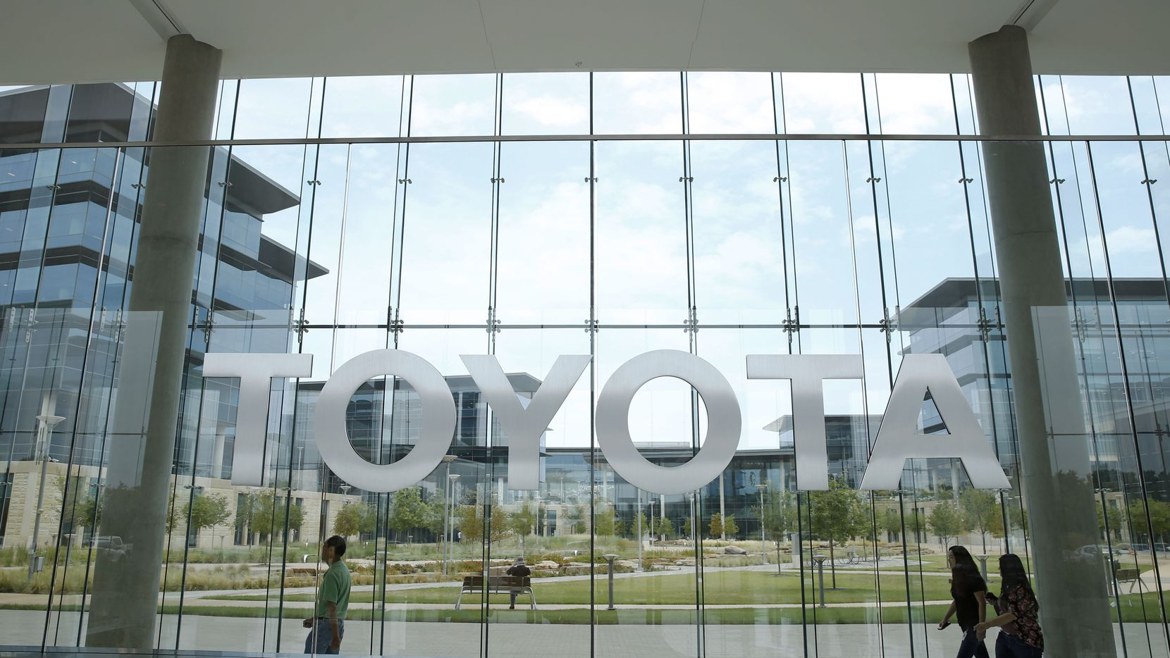 Toyota employees walked by the lobby area at Toyota Motors North America in Plano in 2018.