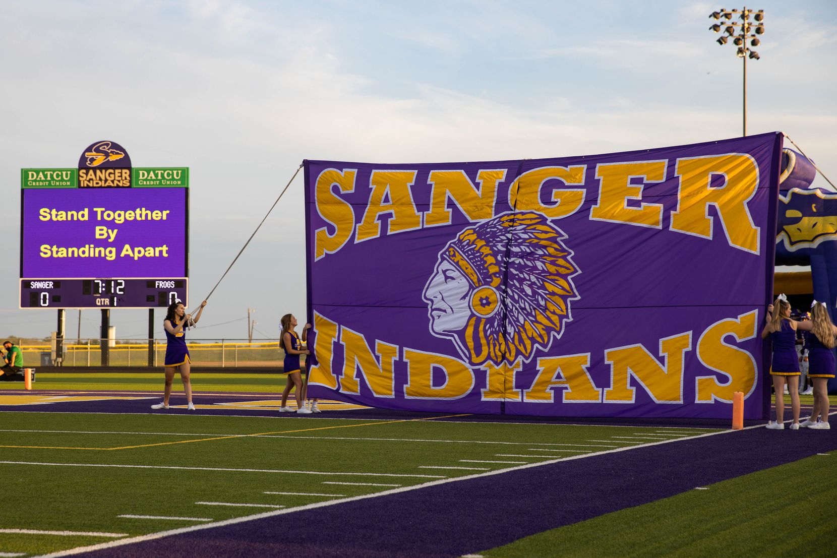 Sanger High School cheerleaders holds a banner before the start of a game against Lake Worth High School on Sept. 4, 2020 in Sanger. Sanger leads 26-14 at halftime. (Juan Figueroa/ The Dallas Morning News)