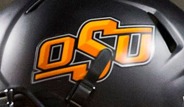 Oklahoma State football logo on a helmet.