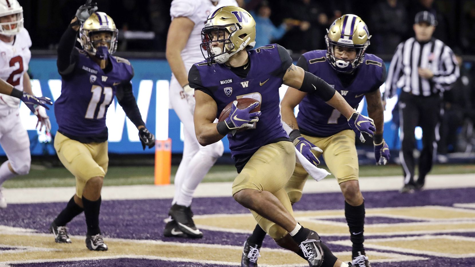 FILE - Washington safety Taylor Rapp (7) comes down with an interception in the end zone on the final play of a game against Stanford on Saturday, Nov. 3, 2018, in Seattle. (AP Photo/Elaine Thompson)