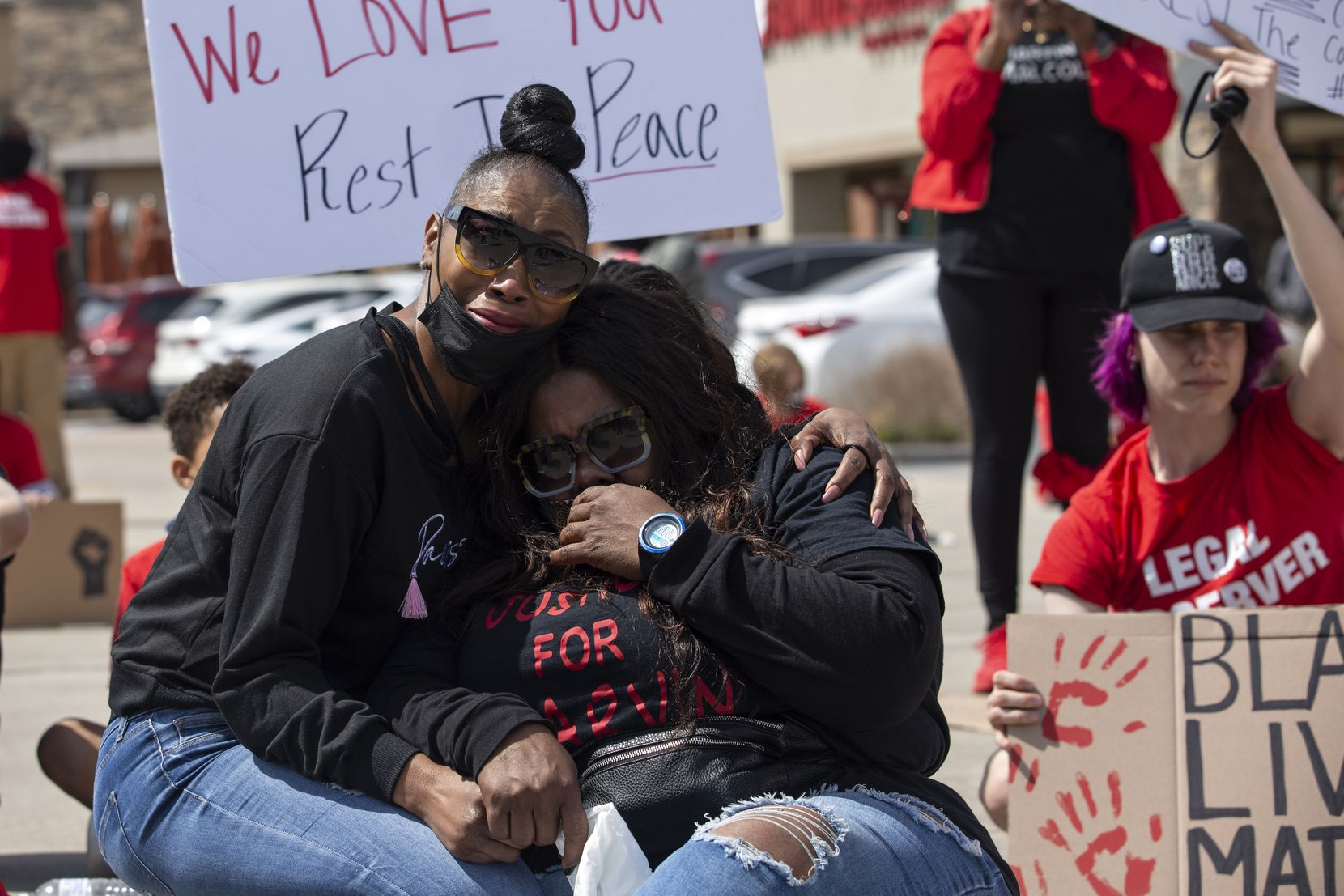 Pynun Stevenson comforts Lassandra Scott at the Allen Outlets on Sunday, March 21, 2021 demanding justice for LassandraÕs son Marvin Scott III, who died a week prior while in custody at the Collin County Jail on March 14, 2021. Marvin Scott III was arrested at the Allen Outlets for possession of less than two ounces of marijuana. Demonstrators called for the arrest of the ÒCollin County SevenÓ, the seven Collin County Jail employees who were placed on leave after MarvinÕs death. (Shelby Tauber/Special Contributor)