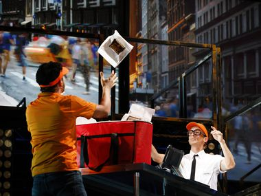"""Blake Hackler (right) and Christopher Llewyn Ramirez play fast-food workers in Dallas Theater Center's production of """"Working: A Musical"""" at Strauss Square in the Dallas Arts District. Based on Studs Terkel's 1974 oral history of working-class Americans, it features real-life characters singing about their jobs and lives."""