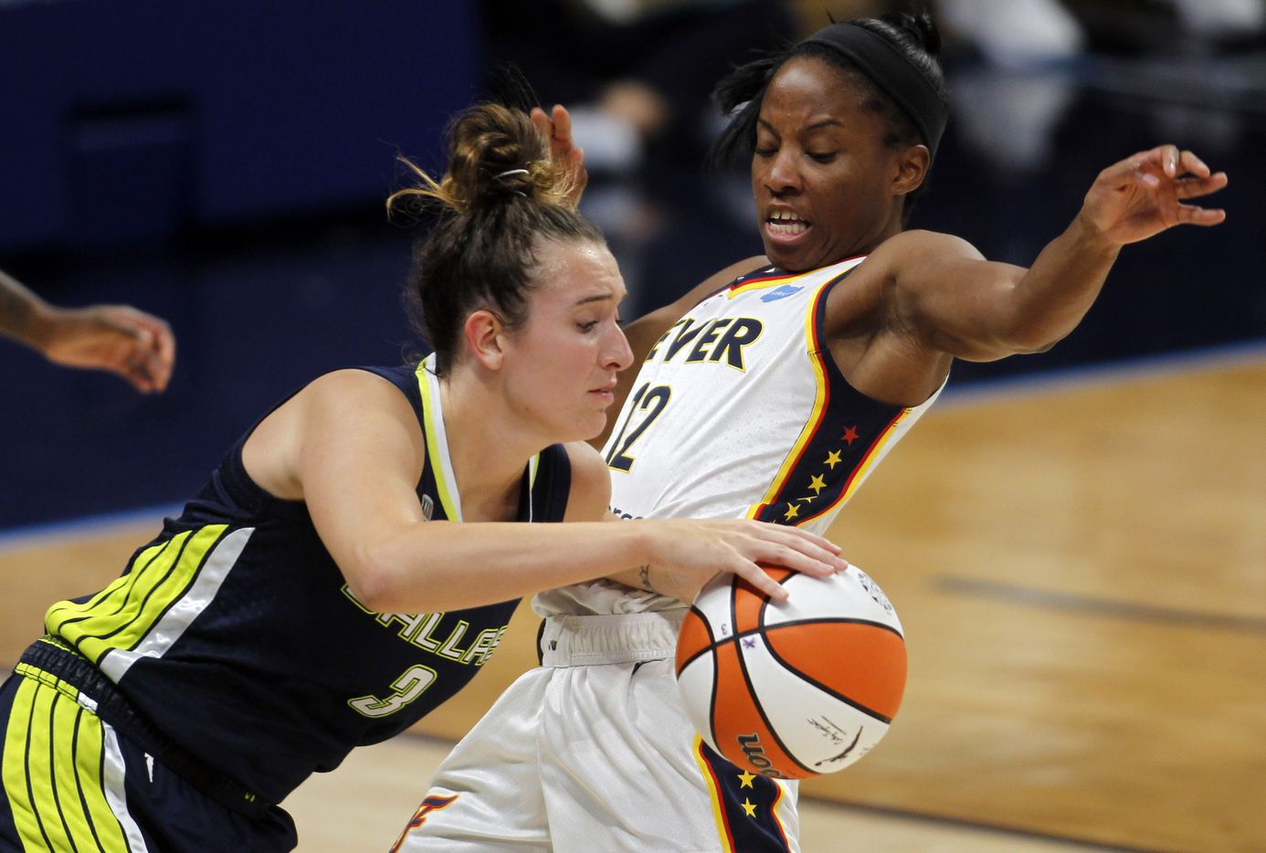 Dallas Wings guard Marina Mabry (3), left, drives against the defense of Indiana Fever guard Lindsay Allen (12) during first half action. The Dallas Wings hosted the Indiana Fever for their WNBA game held at College Park Center on the campus of UT-Arlington on August 20, 2021. (Steve Hamm/ Special Contributor)