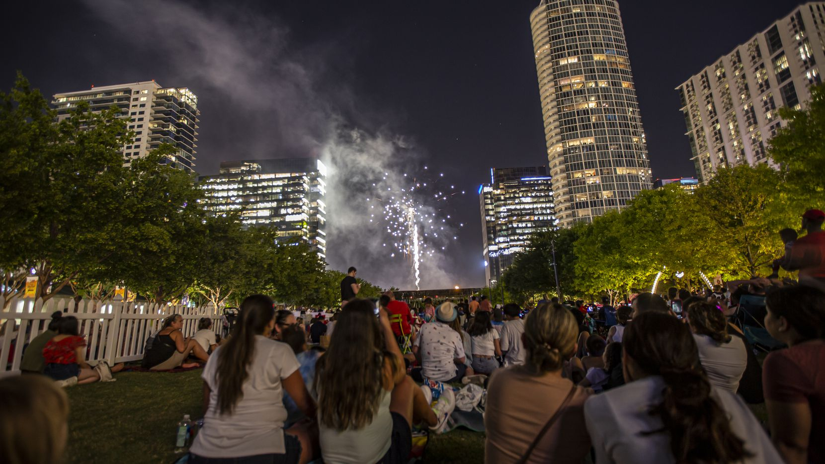 Fireworks light up the skyscrapers of downtown and uptown during a fourth of July celebration at Klyde Warren Park, Saturday, June 26, 2021.