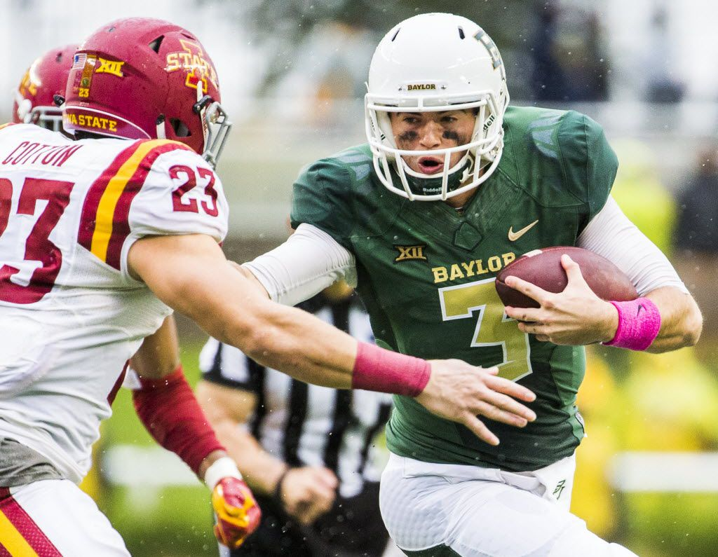 Baylor Bears quarterback Jarrett Stidham (3) fends off Iowa State Cyclones defensive back Darian Cotton (23) during the fourth quarter of their game on Saturday, October 24, 2015 at McLane Stadium in Waco, Texas.