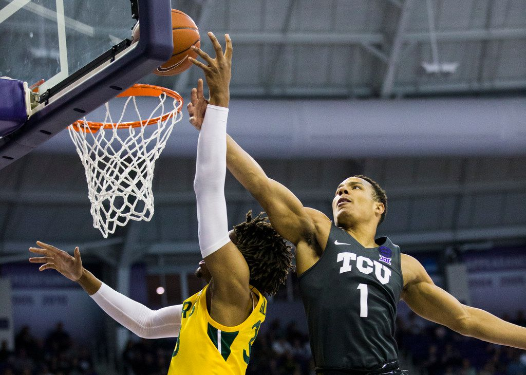 TCU Horned Frogs guard Desmond Bane (1) blocks the shot of Baylor Bears forward Freddie Gillespie (33) during the first half of an NCAA mens basketball game between Baylor and TCU on Saturday, February 29, 2020 at Ed & Rae Schollmaier Arena on the TCU campus in Fort Worth. (Ashley Landis/The Dallas Morning News)
