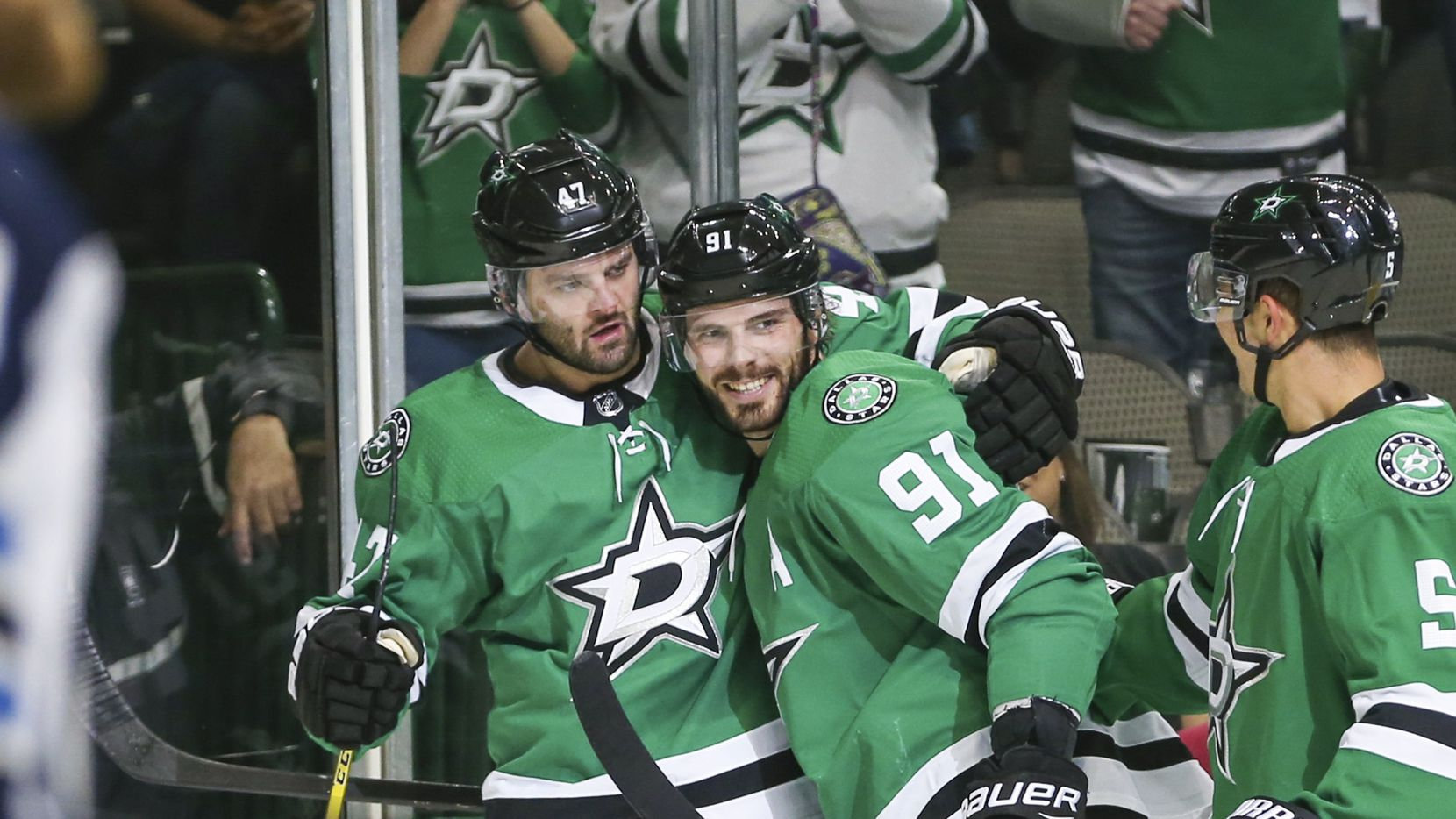 Dallas Stars right wing Alexander Radulov (47), center Tyler Seguin (91) and defenseman Connor Carrick (5) celebrate a goal during the first period of a game between the Dallas Stars and the Winnipeg Jets on Saturday, Oct. 6, 2018 at American Airlines Center in Dallas.