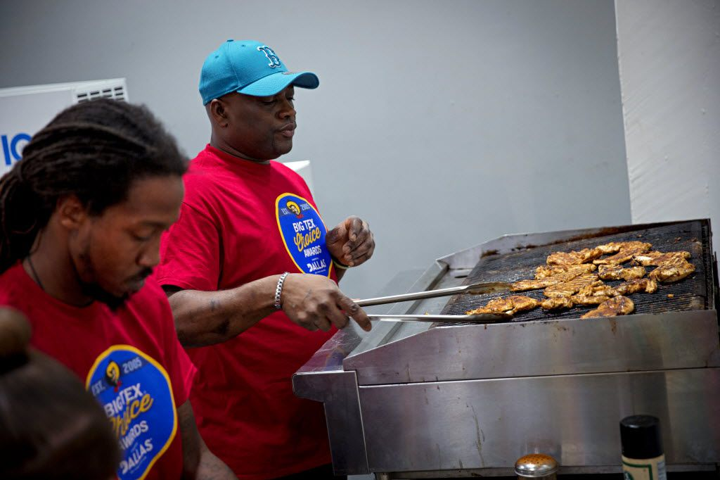 Oliver Williams (center) grills chicken as he and his team work on their entry of Caribbean pineapple korn-a-copia during the 2016 Big Tex Choice Awards Sunday, August 28, 2016 at Fair Park in Dallas. The annual event, held ahead of the State Fair of Texas, recognizes the best fried foods entered into consideration for sale at the fair. (G.J. McCarthy/The Dallas Morning News)