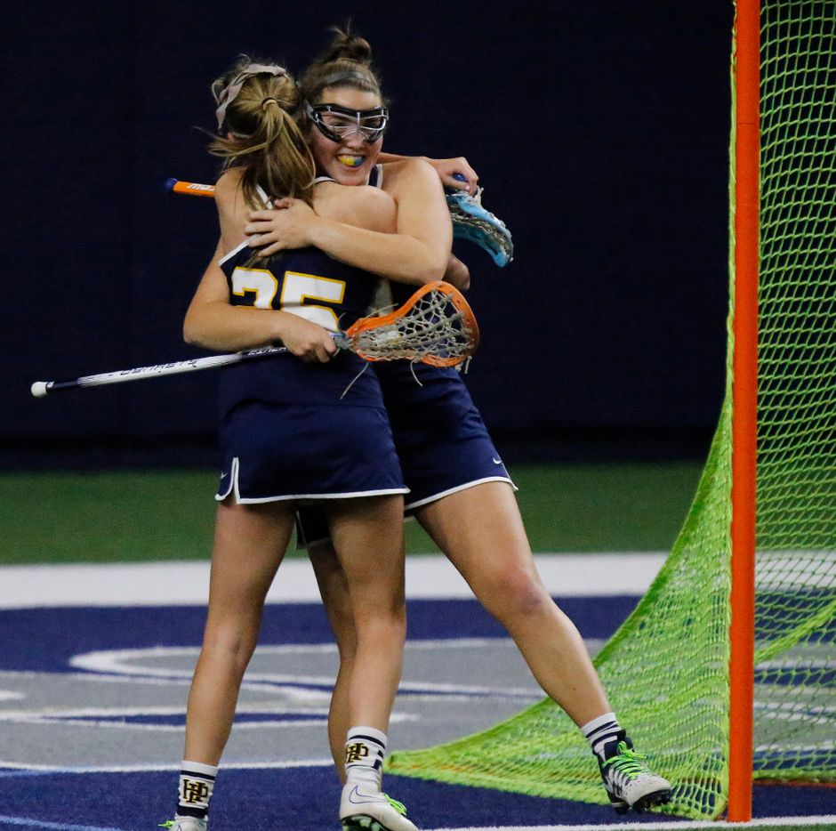 Highland Park's Rebekah Miller (25) embraces Mira Martin (24) after Martin scored a goal during the first half as Highland Park played the Frisco Fury as part of the Patriot Cup lacrosse tournament at The Ford Center at The Star in Frisco on Saturday, February 18, 2017. (Stewart F. House/Special Contributor)