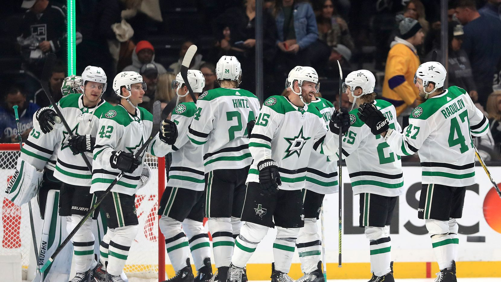 LOS ANGELES, CALIFORNIA - JANUARY 08:  Alexander Radulov #47, Taylor Fedun #42, Roope Hintz #24, Blake Comeau #15, Joel Kiviranta #25, and Anton Khudobin #35 of the Dallas Stars celebrate after defeating the Los Angeles Kings 2-1 in a game at Staples Center on January 08, 2020 in Los Angeles, California.