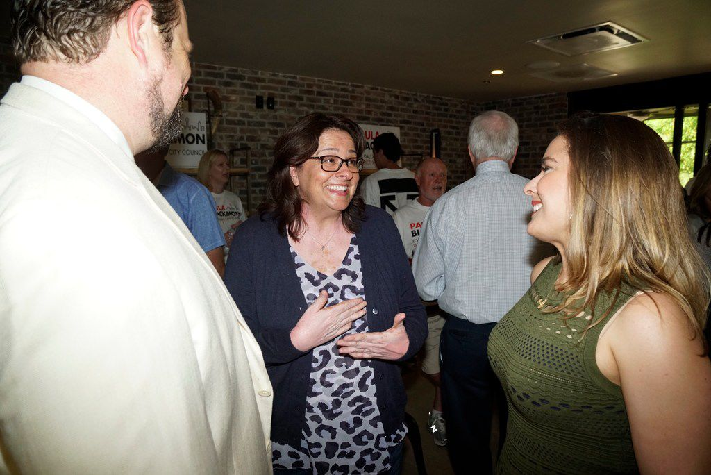 Paula Blackmon, center, talks with John Botefuhr, left, and Anne Maurer, right, during her runoff watch party at Local Traveler in Dallas, TX on Saturday, June 8, 2019.