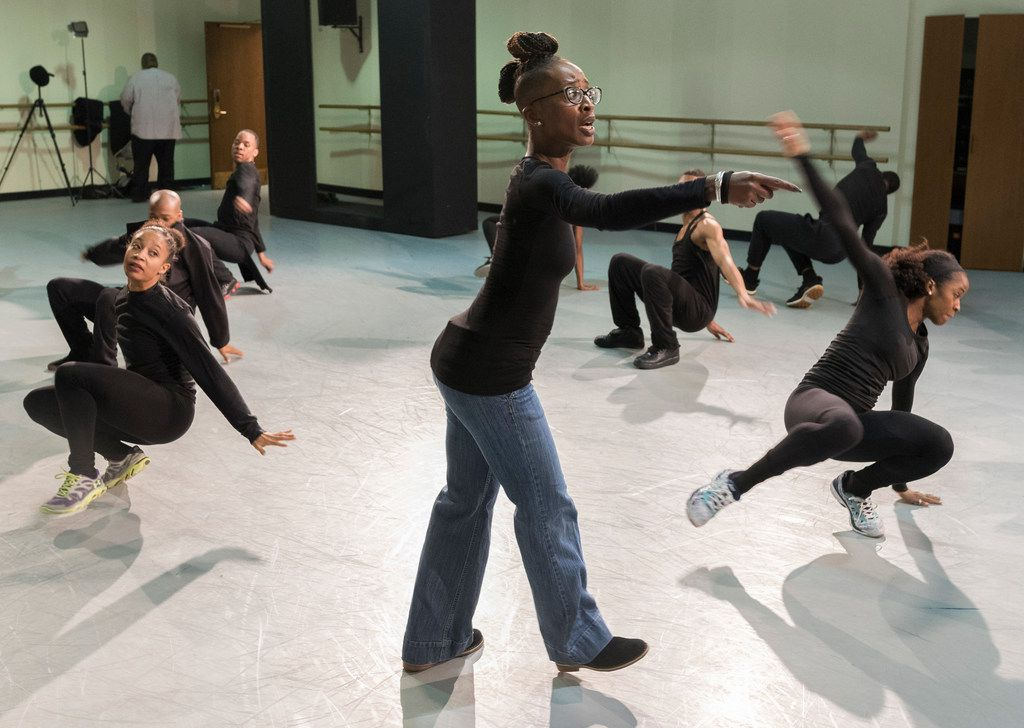 Dallas Black Dance Theatre rehearses Displaced, Yet Rebirthed.  The piece, premiering locally Feb. 16, is choreographed by Hurricane Katrina survivor Michelle N. Gibson, center.