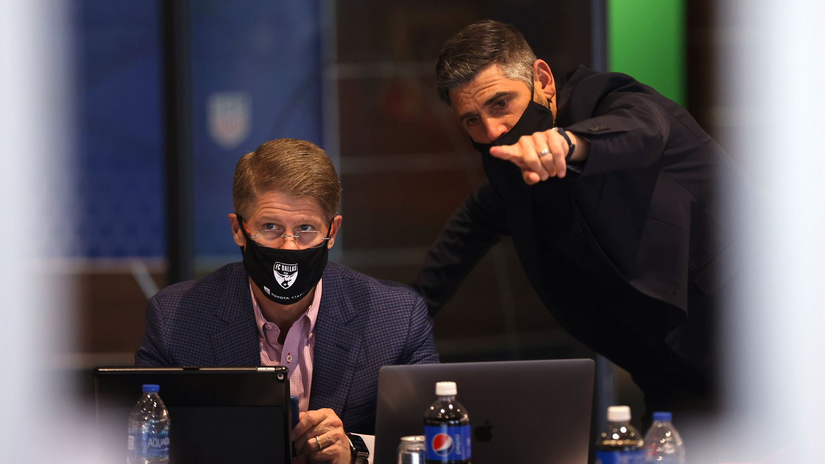 Luchi Gonzalez (right), FC Dallas head coach points towards the board of players as he talks to  Clark Hunt, FC Dallas president during round 1of  the MLS SuperDraft at Toyota Stadium on Thursday, January 21, 2021in Frisco, Texas.
