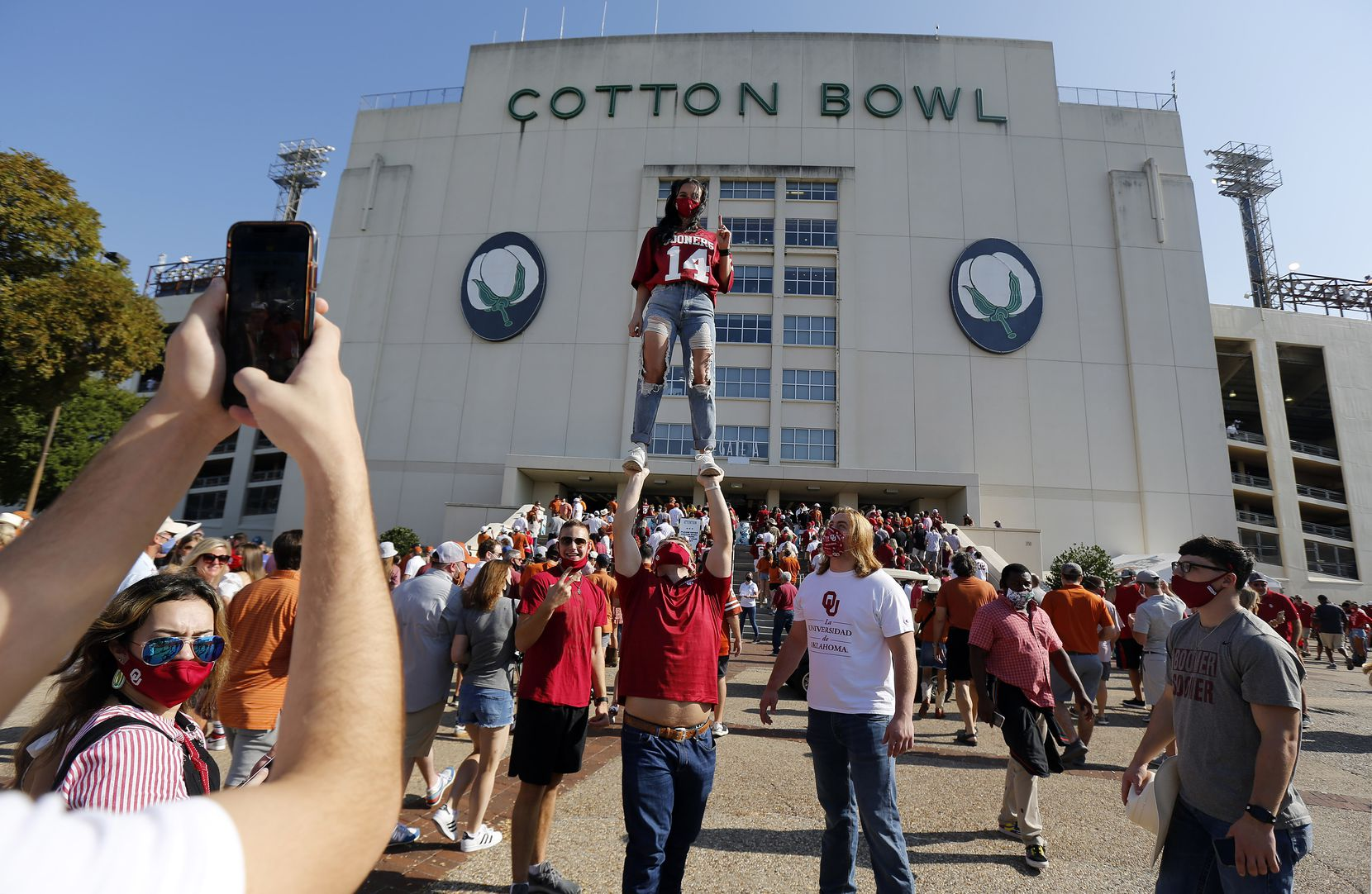Emily Bingger of Norman has her photo taken in front of the Cotton Bowl before the Red River Rivalry in Dallas, Saturday, October 10, 2020.