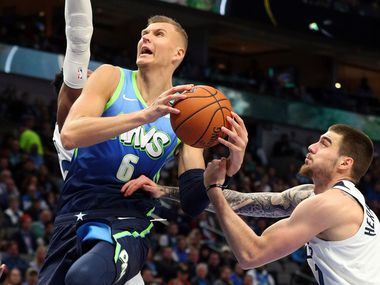 Dallas Mavericks forward Kristaps Porzingis (6) is fouled by Minnesota Timberwolves forward Juan Hernangomez (41) as he goes up to shoot in the second half during an NBA basketball game on Monday, Feb. 24, 2020, in Dallas.