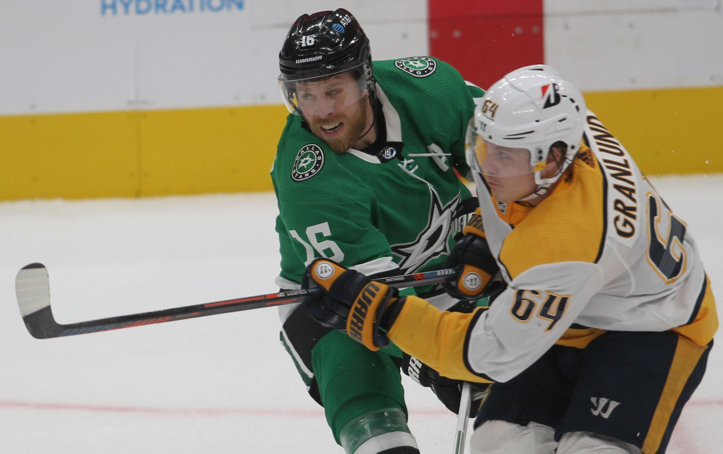 Dallas Stars' Joe Pavelski (16) tangles with Nashville Predators' Mikael Granlund (64) during the third period of play. The Stars won, 3-2. The two teams played their NHL game at the American Airlines Center in Dallas on January 24 , 2021. (Steve Hamm/ Special Contributor)