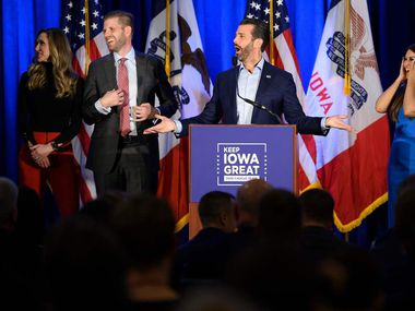 "Donald Trump Jr. (C) speaks with his brother Eric (2nd L) and wife Lara, as well as his girlfriend Kimberly Guilfoyle (R) during a ""Keep Iowa Great"" press conference in Des Moines, IA, on February 3, 2020. (Photo by JIM WATSON / AFP) (Photo by JIM WATSON/AFP via Getty Images)"