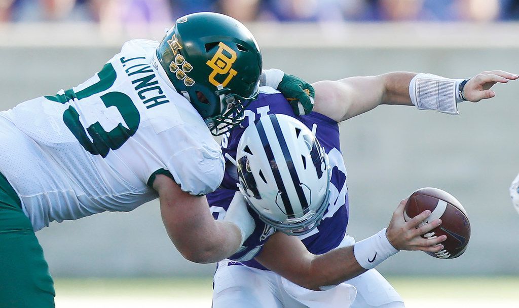 Baylor defensive tackle James Lynch (93) drags down Kansas State quarterback Skylar Thompson (10) in the fourth quarter at Snyder Family Stadium in Manhattan, Kan., on Saturday, Oct. 5, 2019. Baylor won, 31-12.