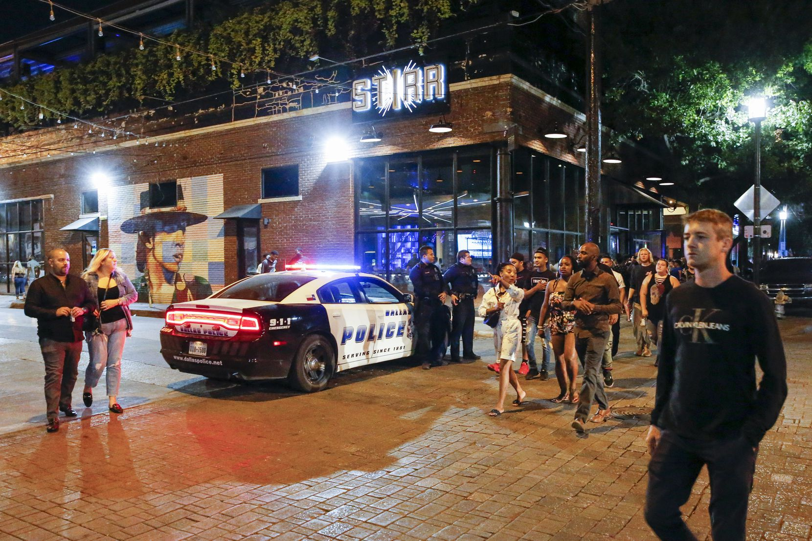 Dallas police officers stand on patrol at Crowdus and Main streets in Deep Ellum. Block after block in the entertainment district, the Dallas Police Department was on the scene to help ensure safety.