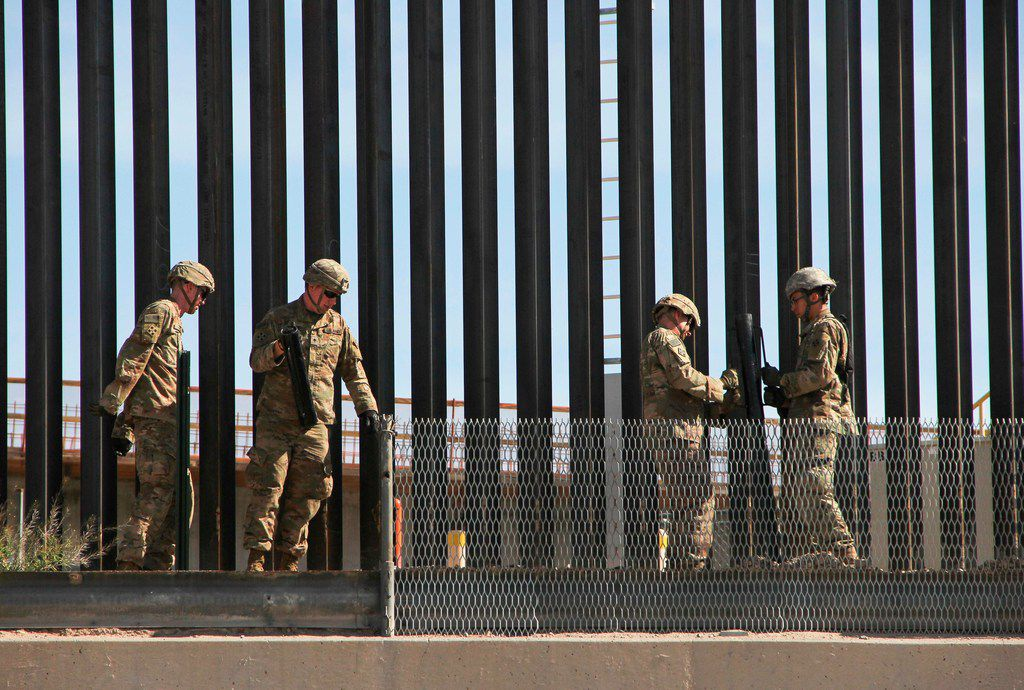 U.S. soldiers reinforce the US-Mexico border fence in El Paso, Texas state, US, as seen from Ciudad Juarez, Chihuahua state, Mexico on April 4, 2019. - US President Donald Trump is expected to visit a section of the border fence in Calexico during his tour to California on Friday. (Photo by Herika Martinez / AFP)HERIKA MARTINEZ/AFP/Getty Images