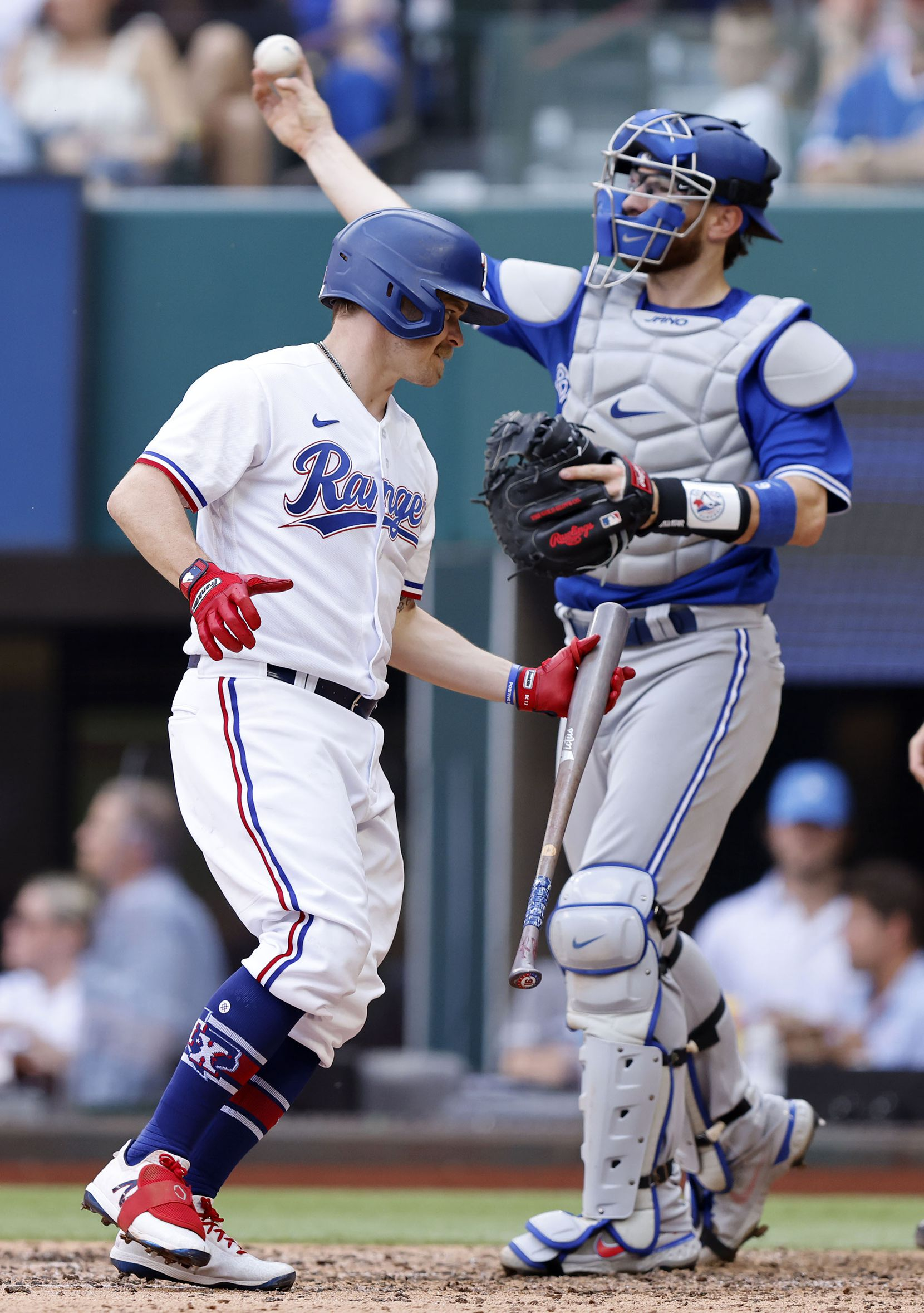 Texas Rangers second baseman Brock Holt (16) strikes out during fifth inning against the Toronto Blue Jays at Globe Life Field in Arlington, Monday, April 5, 2021. The Texas Rangers were facing the Toronto Blue Jays in their home opener. (Tom Fox/The Dallas Morning News)