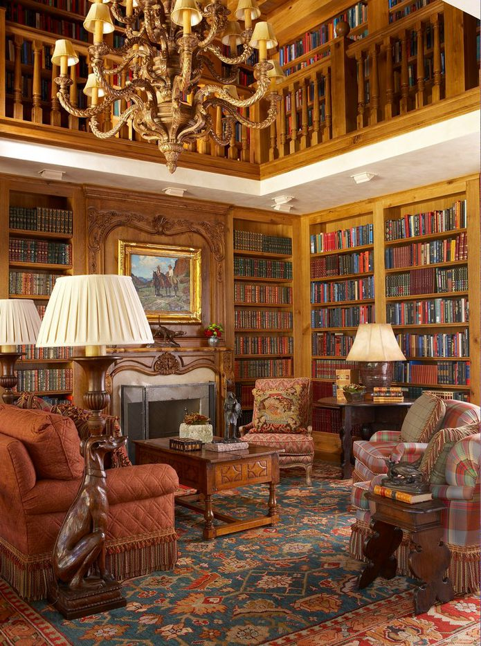The Lodge at Mesa Vista ranch has a library with a spiral staircase.