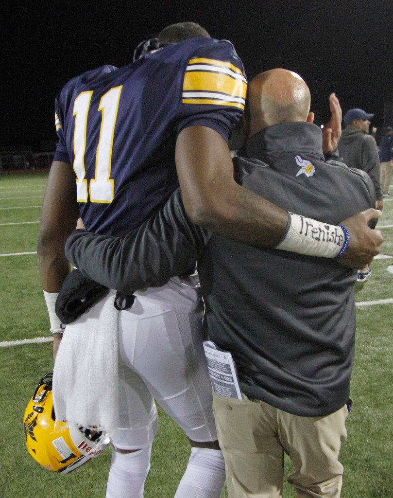 Arlington Lamar head coach Laban DeLay shares a consoling hug with Vikings receiver Cam Brady (11) following his inspirational speech on the heels of their 55-49 season-ending loss to Midland Lee. The two teams played their Class 6A Division l area round football playoff game at Cravens Field on the campus of Lamar High School in Arlington on November 23, 2019. (Steve Hamm/ Special Contributor)