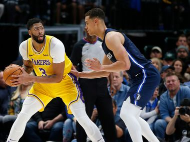 Los Angeles Lakers forward Anthony Davis (3) posts up Dallas Mavericks forward Dwight Powell (7) during the first quarter of play at American Airlines Center in Dallas on Friday, November 1, 2019.