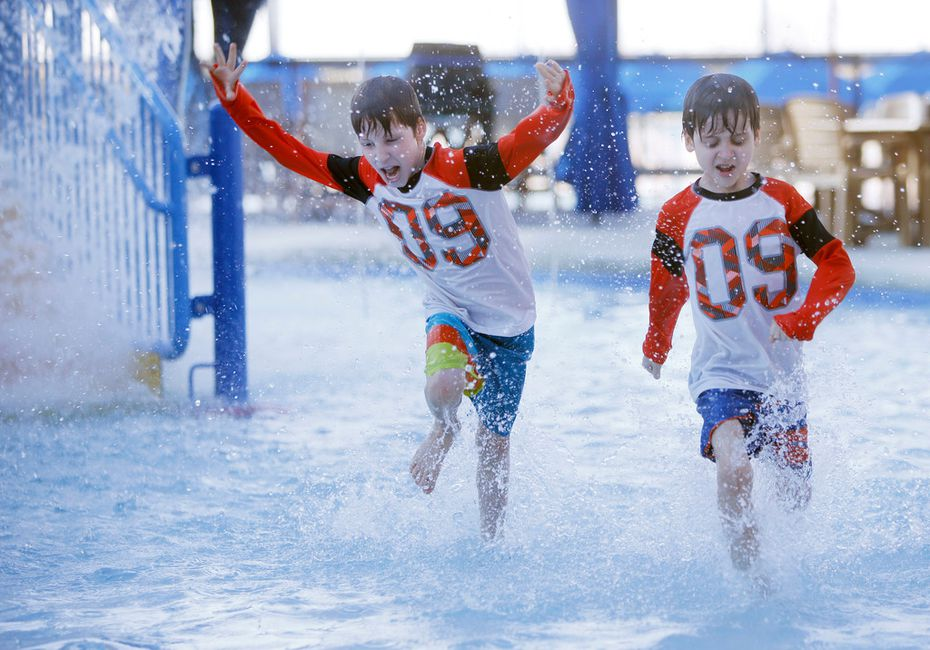 Twin brothers Jace Akin, 7, (right) and Jett Akin get an early glimpse of Epic Waters during a soft opening.