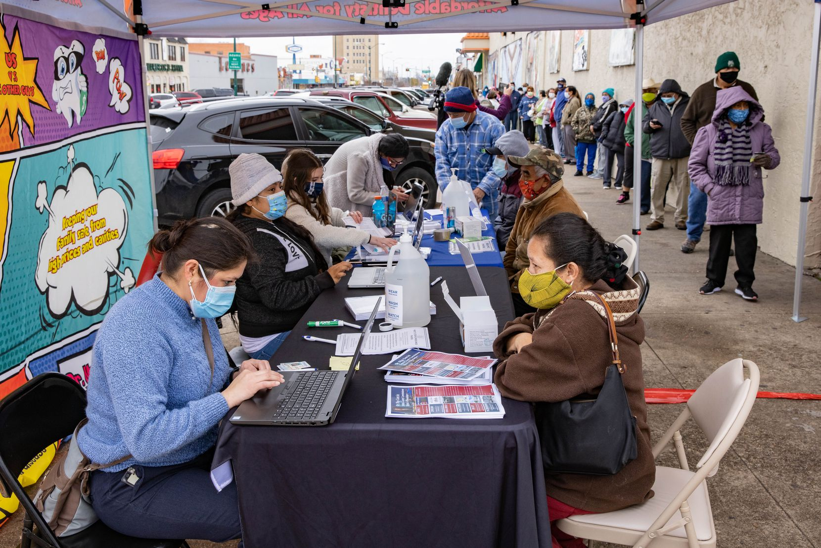 People 65 and older or at least 16 with underlying medical conditions register for a COVID-19 vaccine appointment outside of Jerry's Supermarket on West Jefferson Boulevard in Dallas on Friday, Jan. 22, 2021. (Juan Figueroa/ The Dallas Morning News)
