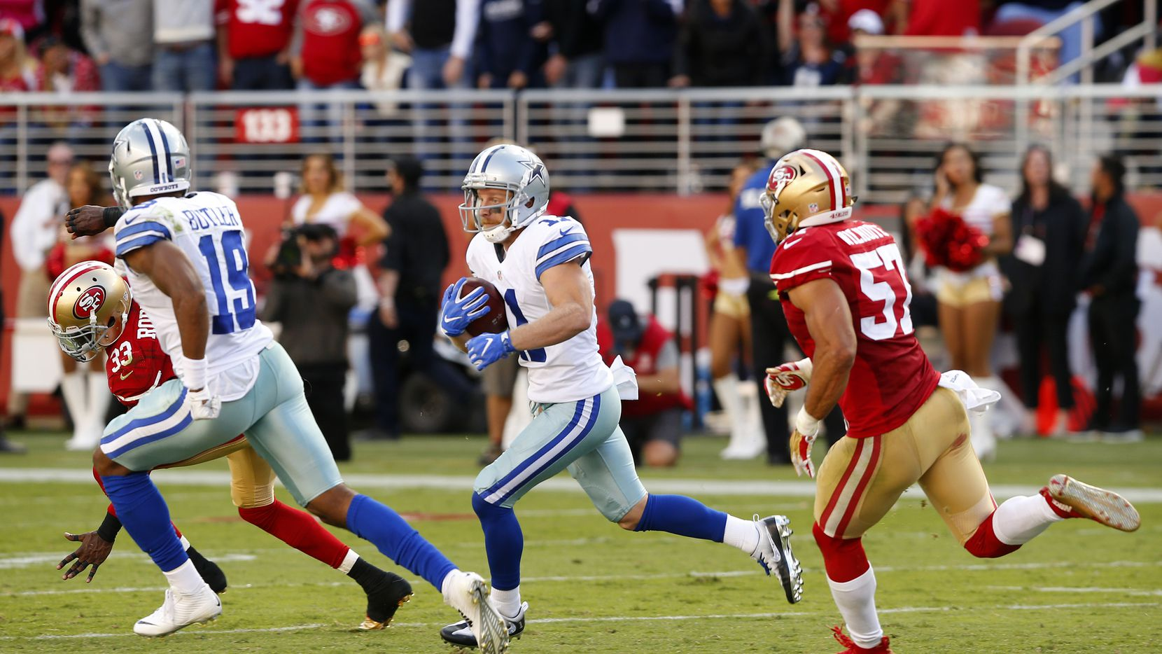 Dallas Cowboys wide receiver Cole Beasley (11) races across  the field as he is pursued by San Francisco 49ers inside linebacker Michael Wilhoite (57) in the third quarter at Levi's Stadium in Santa Clara, California, Sunday, October 2, 2016.(Tom Fox/The Dallas Morning News)