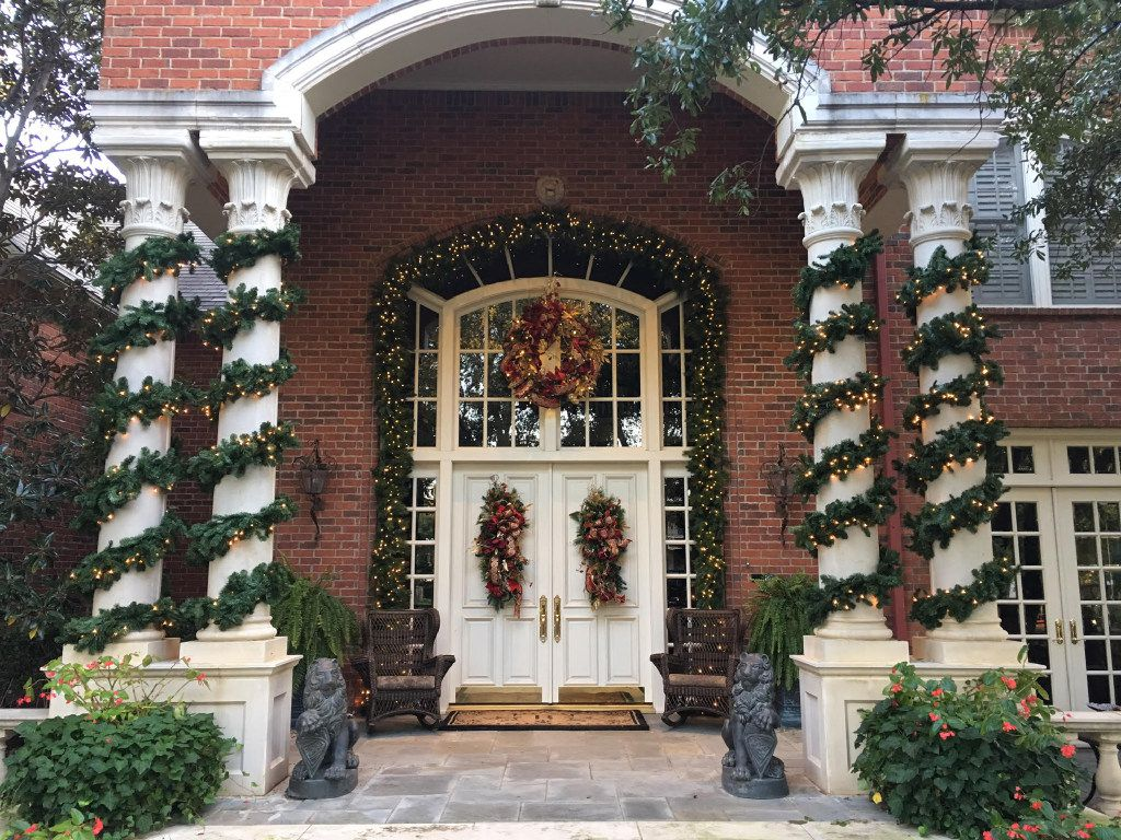 Exterior features like these tall columns wrapped in a wide garland draw attention to a doorway.