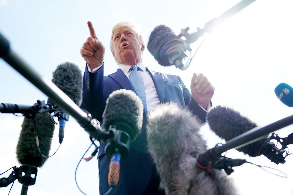 President Donald Trump talks to journalists on the South Lawn of the White House before boarding Marine One and traveling to Walter Reed National Military Medical Center on October 04, 2019.