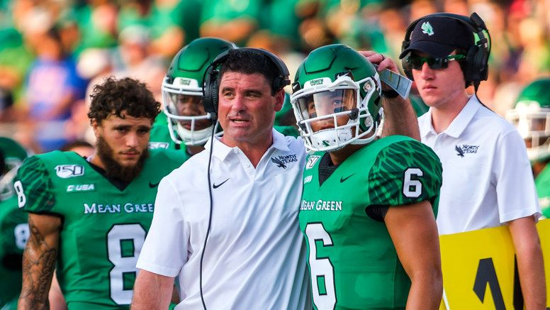 UNT head coach Seth Littrell talks with his players the sidelines during the first half against SMU at Ford Stadium on Saturday, Sept. 7, 2019.