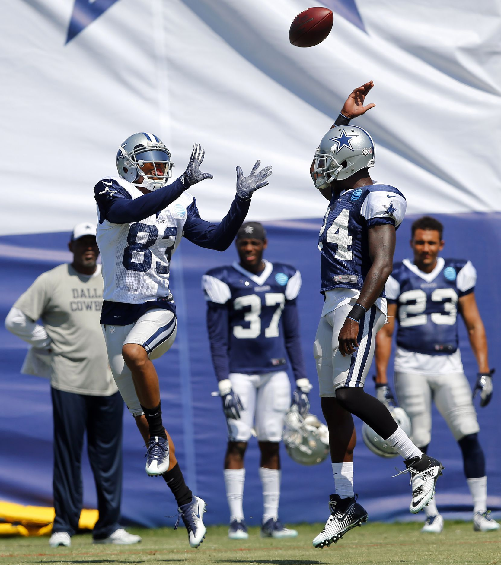 Dallas Cowboys wide receiver Terrance Williams (83) goes up to grab a pass over cornerback Morris Claiborne (24) during morning practice at training camp in Oxnard, California, Thursday, August 11, 2016. (Tom Fox/The Dallas Morning News)